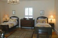 Red Room has two twin beds and bureau